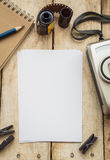 Blank paper with photo film in cartridge and film camera Royalty Free Stock Image