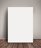 Blank Paper Poster Mock Up Leaning Against Wall. Blank Paper Poster Mock Up Leaning Against  Gray Wall as Copy Space for Design and Text Royalty Free Stock Photos