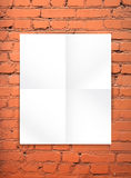 Blank paper poster on the red brick wall. Blank paper poster on the red brick wall background. You can place your design and apply Transparency with Multiply Royalty Free Stock Image