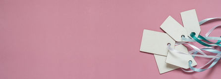 Blank paper price sale tags On pink background. Banner format Royalty Free Stock Photo