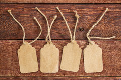 Blank paper price tags on rustic barn wood stock photo