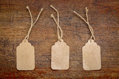 Blank paper price tags on rustic wood Royalty Free Stock Photos