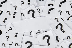Blank paper with question marks Royalty Free Stock Image