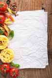 Blank paper for recipes with ingredients tomatoes pasta pepper Royalty Free Stock Images