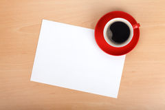Blank paper and red coffee cup Royalty Free Stock Images