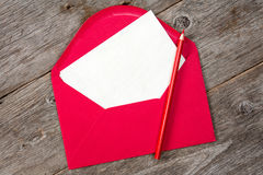Blank paper, red envelope and pencil Royalty Free Stock Photography