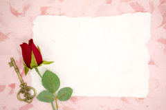 Blank paper with red rose and old key Stock Image