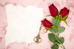 Blank paper with red rose and old key Stock Photos