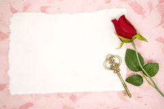 Blank paper with red rose and old key Royalty Free Stock Photos