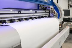 Blank paper roll in large printer format inkjet machine for industrial business royalty free stock photography