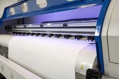 Blank paper roll in large printer format inkjet machine for industrial business royalty free stock photo