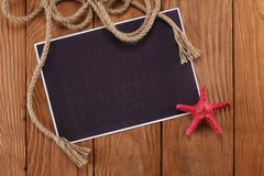 Blank paper with rope and starfish Royalty Free Stock Photo