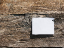 Blank paper on the rustic wooden wall Royalty Free Stock Image