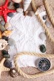 Blank paper on sand beach Stock Photos