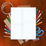 Blank paper with school supplies tools on wood background Royalty Free Stock Photography