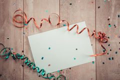 Blank paper sheet with bow on wooden background Royalty Free Stock Image