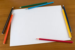 Blank paper sheet and color pencils on table Royalty Free Stock Images