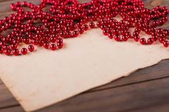 Blank paper sheet and garland Stock Photography