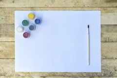 Blank paper sheet gouache and brush. Preparing for painting stock images