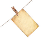 Blank paper sheet hanging on a rope Royalty Free Stock Images