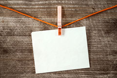 Blank paper sheet hanging on a rope Stock Images