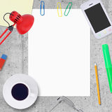 Blank paper sheet with office work elements around Stock Photo