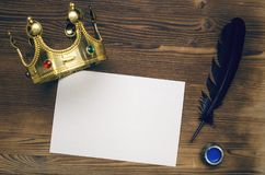 Vip agreement mock up. Special offer. Blank paper sheet with pen and golden crown on wooden table background. Vip agreement. Premium contract. Special offer Stock Images