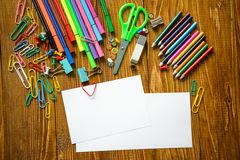 Blank paper sheet with pencils and scissors Royalty Free Stock Photos