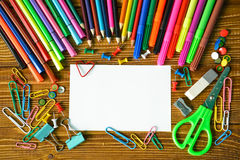 Blank paper sheet with pencils and scissors Royalty Free Stock Photo
