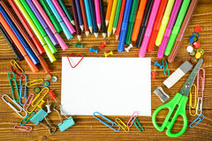 Blank paper sheet with pencils and scissors Stock Photos