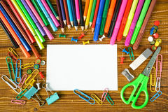 Blank paper sheet with pencils and scissors Royalty Free Stock Images