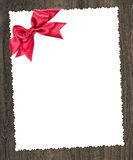 Blank paper sheet with red bow Stock Photography