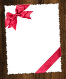 Blank paper sheet with red bow Stock Photo