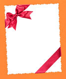 Blank paper with red bow on yellow Royalty Free Stock Photos