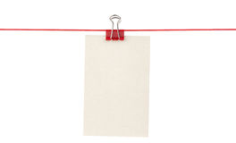 Blank paper sheet on a rope Stock Photos