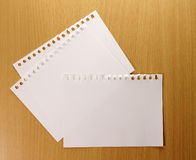 Blank paper sheet on table Stock Images