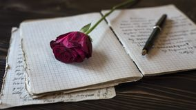 Love story writing. Blank paper sheets on old wooden table, love story writing Stock Photos