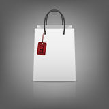 Blank paper shopping bags with sale tag Stock Image