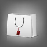 Blank paper shopping bags with sale tag Stock Photography