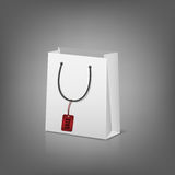 Blank paper shopping bags with sale tag Stock Photos