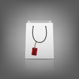 Blank paper shopping bags with sale tag Royalty Free Stock Image