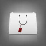 Blank paper shopping bags with sale tag Royalty Free Stock Photography