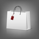 Blank paper shopping bags with sale tag Royalty Free Stock Images