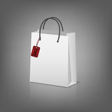 Blank paper shopping bags with sale tag Royalty Free Stock Photo