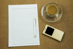Blank paper with smart phone pen and coffee cup on wooden table, business concept Royalty Free Stock Photo