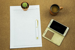 Blank paper with smart phone pen and coffee cup on wooden table, business concept Stock Photo