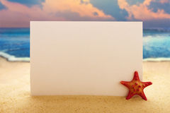 Blank paper with starfish on the sandy beach Stock Photography