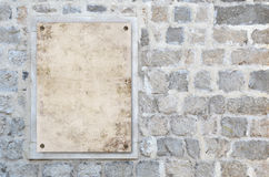 Blank paper on the stone wall Royalty Free Stock Photography