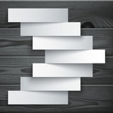 Blank paper stripe banners arrow on dark grey wood Stock Images