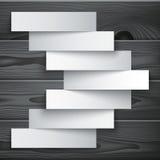 Blank paper stripe banners arrow on dark grey wood Stock Images